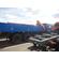 КМУ PALFINGER РК-15500А на КАМАЗ 65115-3094-50, передние опоры поворотные, платформа стальная, внутр.размеры 6112х2470х730 мм – фото 1